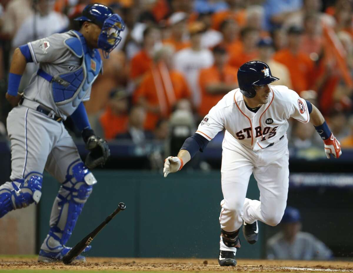 Houston Astros catcher Jason Castro (15) hits a 2RBI single off Kansas City Royals starting pitcher Edinson Volquez, scoring Luis Valbuena and Chris Carter during the fifth inning of Game 3 of the American League Division Series at Minute Maid Park on Sunday, Oct. 11, 2015, in Houston. ( Karen Warren / Houston Chronicle )