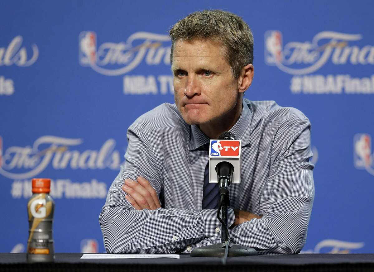 FILE - In this Wednesday, June 10, 2015 file photo, Golden State Warriors head coach Steve Kerr listens to a question during a press conference following Game 3 of basketball's NBA Finals against the Cleveland Cavaliers in Cleveland. Golden State Warriors coach Steve Kerr will take a leave of absence as he recovers from back surgery and will be replaced on an interim basis by Luke Walton. The Warriors announced Thursday, Oct. 1, 2015 that Kerr will need time off for rehabilitation and recovery. (AP Photo/Tony Dejak, File)