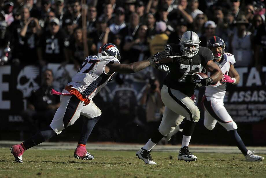 Donald Penn (72) runs with a ball he caught after it was tipped by a Denver defensive player in the fourth quarter. The Oakland Raiders played the Denver Broncos at O.Co Coliseum in Oakland, Calif., on Sunday, October 11, 2015. The Raiders lost 16-10. Photo: Carlos Avila Gonzalez, The Chronicle