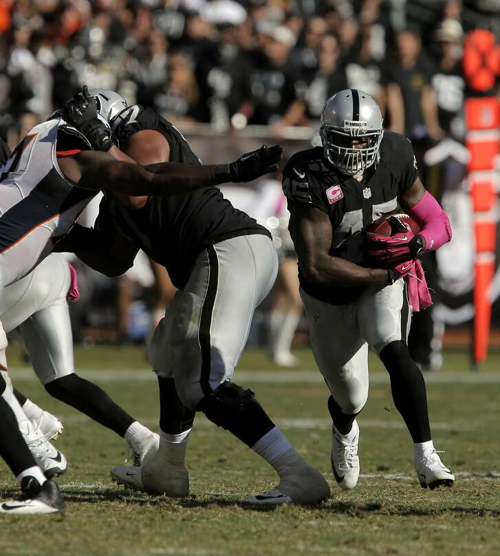 Marcel Reese (45) runs with the ball in the fourth quarter, and had 49 yards receiving , 6 yards rushing, and the Raiders' only touchdown. The Oakland Raiders played the Denver Broncos at O.Co Coliseum in Oakland, Calif., on Sunday, October 11, 2015. The Raiders lost 16-10.