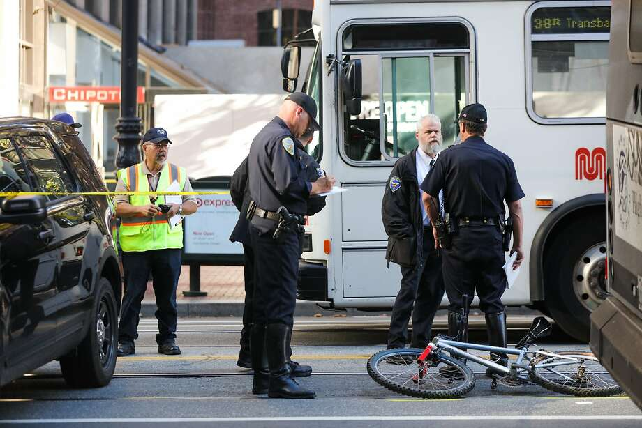 Offciers at the scene where a cyclist was struck and killed by a Muni bus on Market Street in San Francisco, California on Sunday, October 11, 2015. Photo: Gabrielle Lurie, Special To The Chronicle