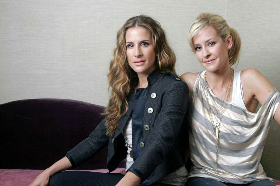 FILE - In this March 23, 2010 file photo, sisters  Emily Robison, left, and Martie Maguire of the Court Yard Hounds are shown in New York. The Court Yard Hounds will perform at the Lollapalooza music festival from Aug. 2 - 4 at Grant Park in Chicago.  (AP Photo/Bruce Gilbert, File) ORG XMIT: NYET758 Photo: BruceGilbert / FR170055
