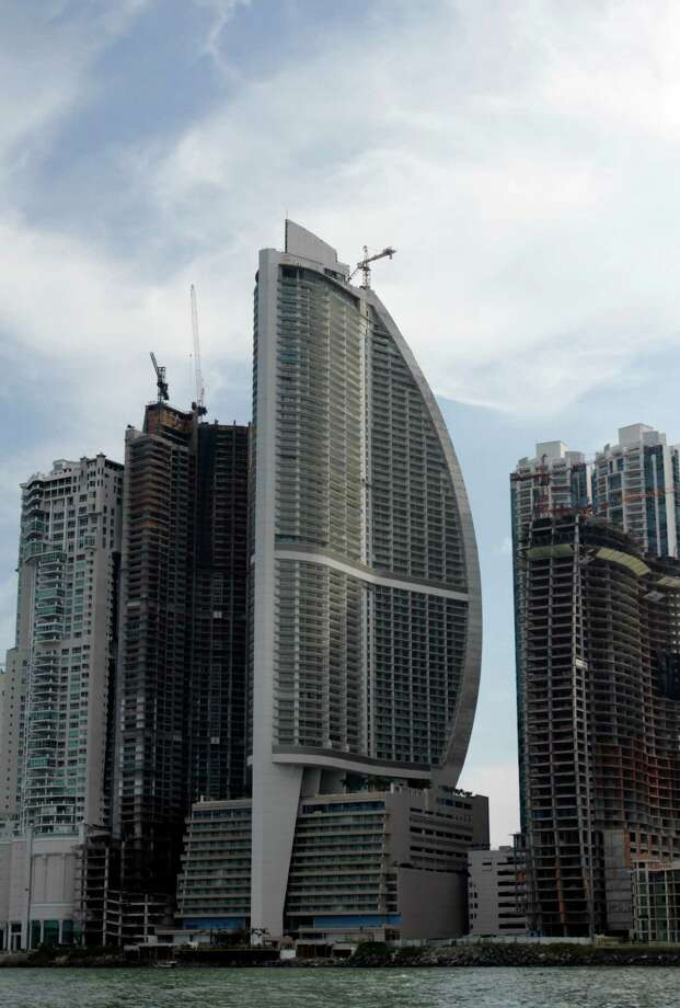 FILE - This July 4, 2011, file photo, shows the Trump Ocean Club International Hotel and Tower, third building from left, in Panama City, Panama. The tale of a 70-story waterfront tower along Panama Bay that was managed by the Trump empire offers insight into the Republican presidential candidate's business traits, and hints about the management style that might be expected from a Trump White House. (AP Photo/Arnulfo Franco) ORG XMIT: WX106 Photo: Arnulfo Franco / AP