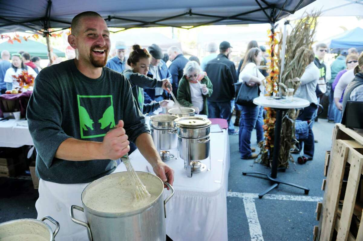 Joe Abbruzzese, kitchen manager of Otis and Olivers in Latham, stirs a pot of their traditional New England clam chowder during TroyOs Chowder Fest on Sunday, Oct. 11, 2015, in Troy, N.Y. In its ninth year, this year featured 25 different homemade chowders from 19 different establishments. (Paul Buckowski / Times Union)