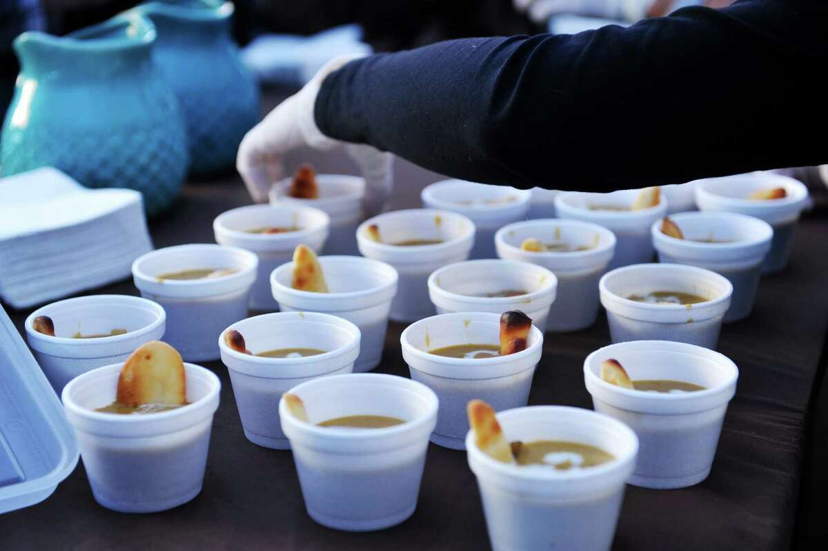 Cups of pumpkin chowder with a sweet cream drizzle and cheese cake fingers being handed out at the City Line Bar and Grill, of Albany, booth during TroyOs Chowder Fest on Sunday, Oct. 11, 2015, in Troy, N.Y. In its ninth year, this year featured 25 different homemade chowders from 19 different establishments. (Paul Buckowski / Times Union)