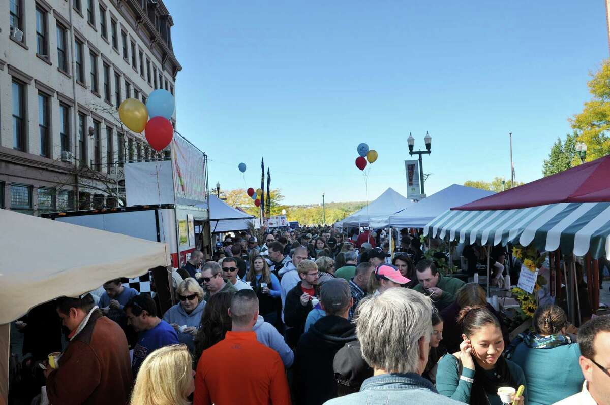 People line up to try different chowders during TroyOs Chowder Fest on Sunday, Oct. 11, 2015, in Troy, N.Y. In its ninth year, this year featured 25 different homemade chowders from 19 different establishments. (Paul Buckowski / Times Union)