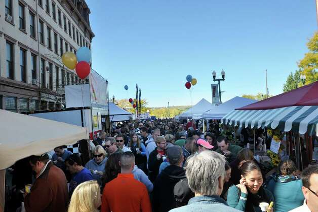 People line up to try different chowders during TroyOs Chowder Fest on Sunday, Oct. 11, 2015, in Troy, N.Y.  In its ninth year, this year featured 25 different homemade chowders from 19 different establishments.  (Paul Buckowski / Times Union) Photo: PAUL BUCKOWSKI / 10033662A