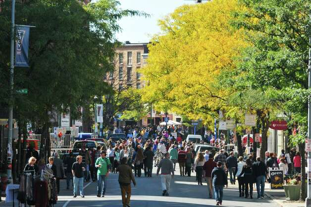 People make their way towards Monument Square during TroyOs Chowder Fest on Sunday, Oct. 11, 2015, in Troy, N.Y.  In its ninth year, this year featured 25 different homemade chowders from 19 different establishments.  (Paul Buckowski / Times Union) Photo: PAUL BUCKOWSKI / 10033662A