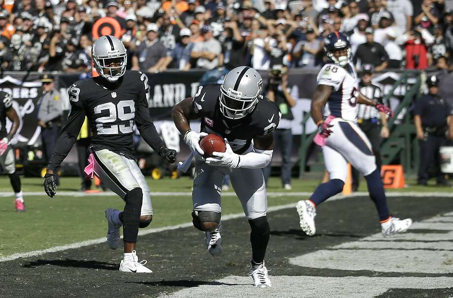 Charles Woodson makes one of his two interceptions, his first ever against Peyton Manning in their 18 seasons in the NFL. Photo: Marcio Jose Sanchez, Associated Press