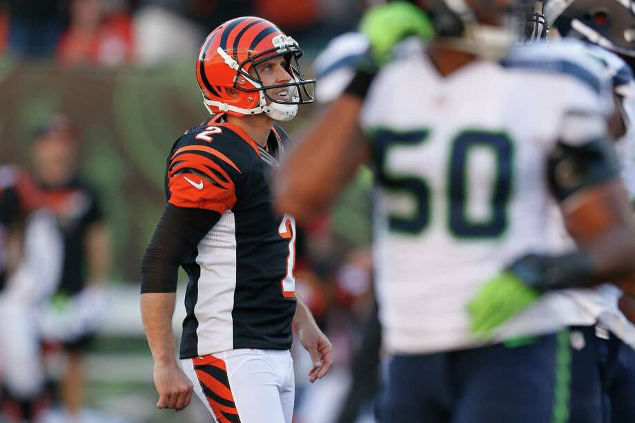 Cincinnati Bengals kicker Mike Nugent smiles after booting the winning field goal in overtime of an NFL football game against the Seattle Seahawks, Sunday, Oct. 11, 2015, in Cincinnati. (AP Photo/Frank Victores) ORG XMIT: OHJM124 Photo: Frank Victores / FR170726 AP