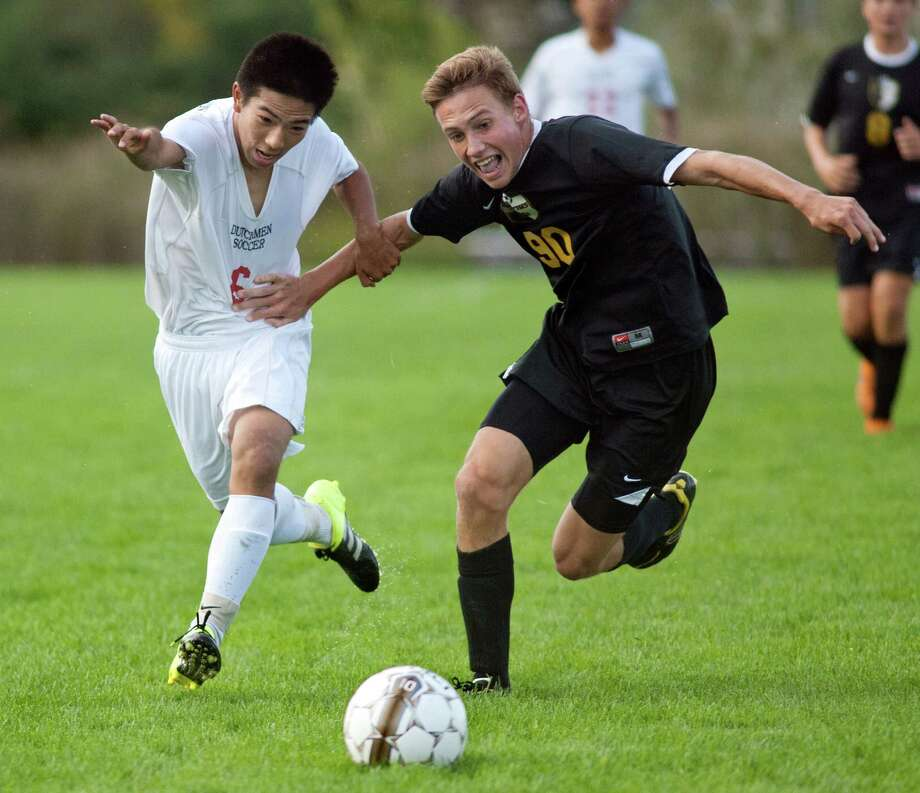 Guilderland's Eddie Yu, left, and Ballston Spa's Meyer Aviles battle for a loose ball during their soccer game on Thursday, Oct. 1, 2015, at Guilderland High in Guilderland N.Y. (Cindy Schultz / Times Union) Photo: Cindy Schultz / 00033520A