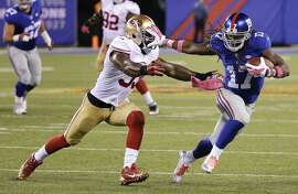 New York Giants wide receiver Dwayne Harris (17) avoids San Francisco 49ers inside linebacker NaVorro Bowman (53) during the second quarter  of an NFL football game, Sunday, Oct. 11, 2015, in East Rutherford, N.J. (AP Photo/Seth Wenig)