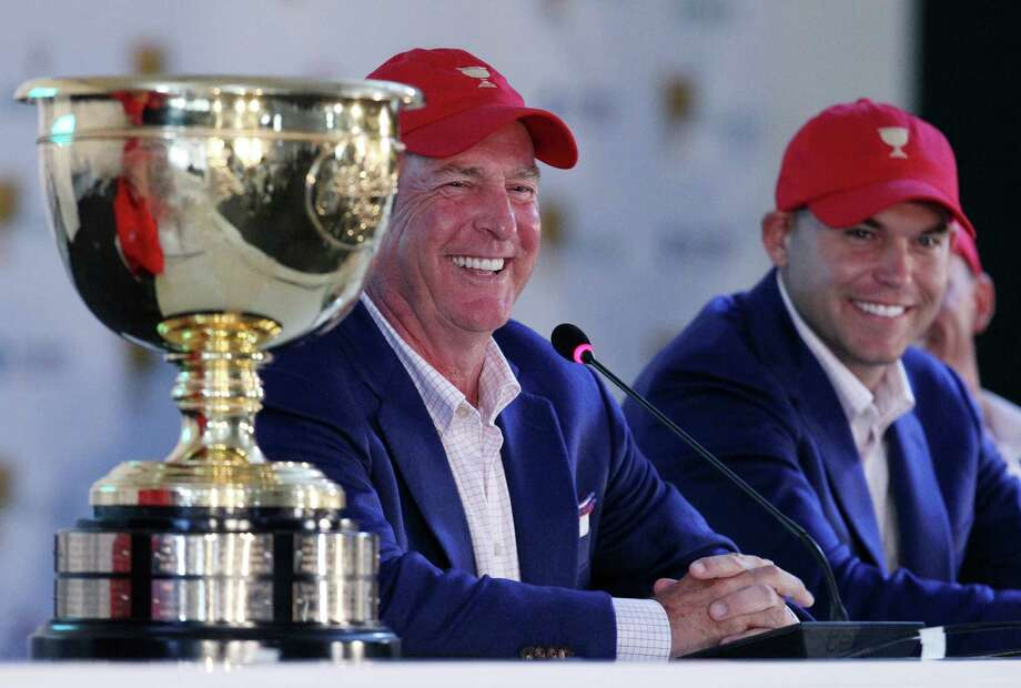US team captain Jay Haas, left and his son Bill address a press conference after they defeated the International team 15 1/2 to 14 1/2 to retain the Presidents Cup at the Jack Nicklaus Golf Club Korea, in Incheon, South Korea, Sunday, Oct. 11, 2015.(AP Photo/Ahn Young-joon) ORG XMIT: XMB192 Photo: Ahn Young-joon / AP