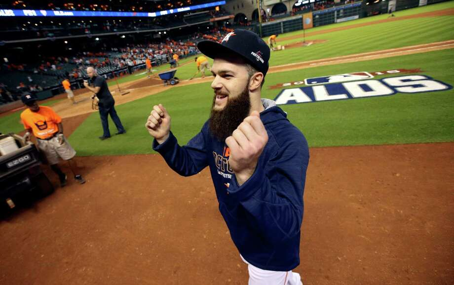 Houston Astros' Dallas Keuchel smiles as he gestures to the stands after winning Game 3 of baseball's American League Division Series against the Kansas City Royals Sunday, Oct. 11, 2015, in Houston. The  Astros won 4-2. (AP Photo/Patric Schneider) ORG XMIT: TXDP144 Photo: Patric Schneider / FR170473 AP