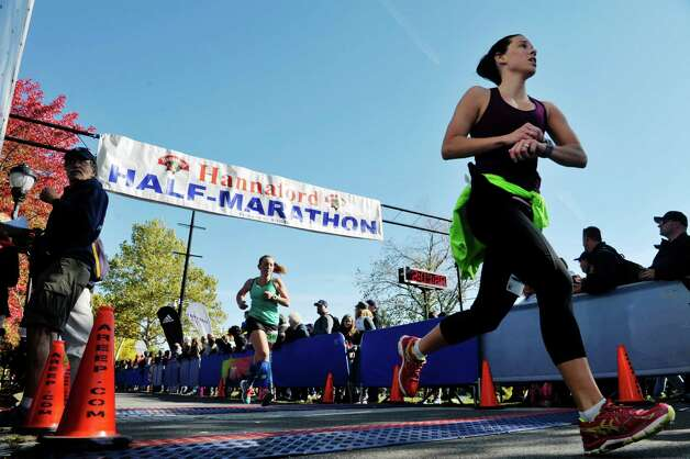 Runners cross the finish line during the Mohawk Hudson River Marathon and the Hannaford Half Marathon on Sunday, Oct. 11, 2015, in Albany, N.Y.  (Paul Buckowski / Times Union) Photo: PAUL BUCKOWSKI / 10033673A