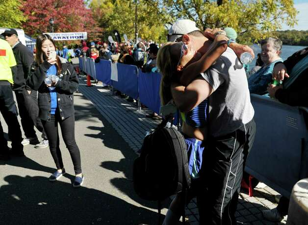 Megan Flowers Skeels of Forth Worth, TX hugs her husband, David Skeels, after finishing first for the women in the marathon portion of the Mohawk Hudson River Marathon and the Hannaford Half Marathon on Sunday, Oct. 11, 2015, in Albany, N.Y.  (Paul Buckowski / Times Union) Photo: PAUL BUCKOWSKI / 10033673A