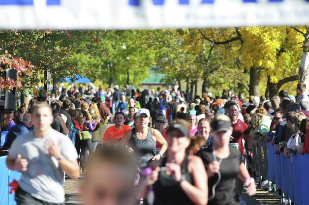 Runners make their way to the finish line during the Mohawk Hudson River Marathon and the Hannaford Half Marathon on Sunday, Oct. 11, 2015, in Albany, N.Y.  (Paul Buckowski / Times Union) Photo: PAUL BUCKOWSKI / 10033673A