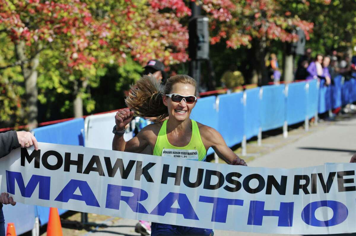 Megan Flowers Skeels of Forth Worth, TX finishes first for the women in the marathon portion of the Mohawk Hudson River Marathon and the Hannaford Half Marathon on Sunday, Oct. 11, 2015, in Albany, N.Y. (Paul Buckowski / Times Union)