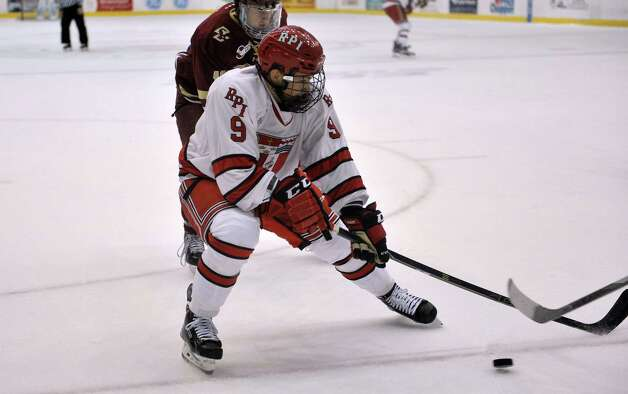 RPI's Meirs Moore tries to keep possession of the puck during their game against Boston College on Sunday, Oct. 11, 2015, in Troy, N.Y.  (Paul Buckowski / Times Union) Photo: PAUL BUCKOWSKI / 10033671A