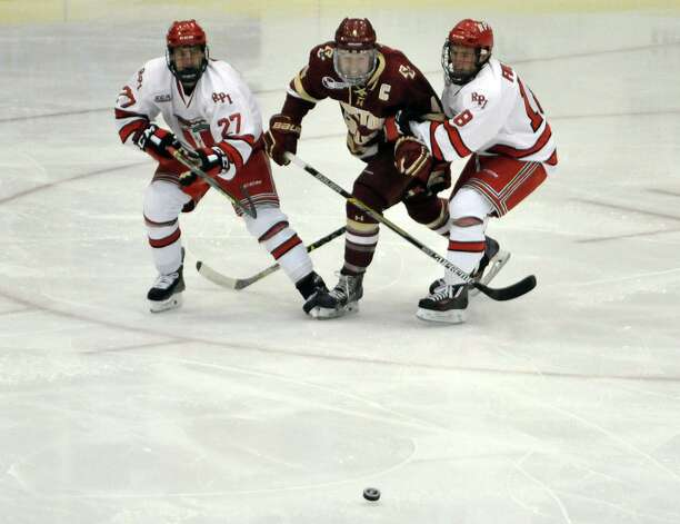 RPI's Jake Wood, left, and Travis Fulton, right, force the puck away from Boston College's Teddy Doherty during their game on Sunday, Oct. 11, 2015, in Troy, N.Y. (Paul Buckowski / Times Union) Photo: PAUL BUCKOWSKI / 10033671A