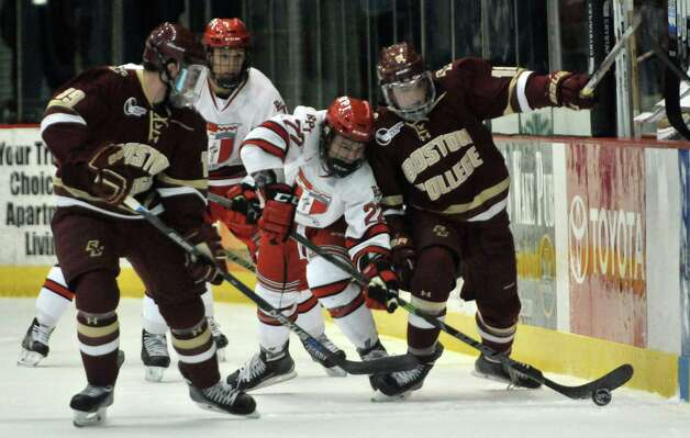 RPI's Bradley Bell fights Boston College players for control of the puck during their game on Sunday, Oct. 11, 2015, in Troy, N.Y. (Paul Buckowski / Times Union) Photo: PAUL BUCKOWSKI / 10033671A