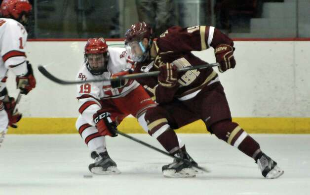 RPI's Mike Prapavessis, left, tries to force the puck away from a Boston College player during their game on Sunday, Oct. 11, 2015, in Troy, N.Y.  (Paul Buckowski / Times Union) Photo: PAUL BUCKOWSKI / 10033671A