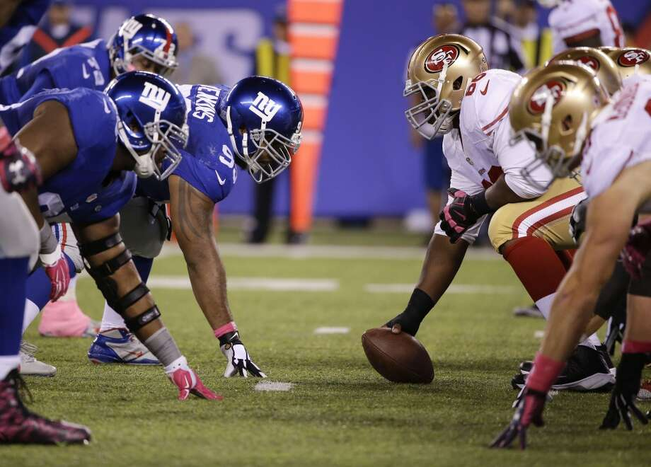 San Francisco 49ers center Marcus Martin (66) prepares to snap the ball on the line of scrimmage against the New York Giants during the second quarter of an NFL football game, Sunday, Oct. 11, 2015, in East Rutherford, N.J. (AP Photo/Seth Wenig) Photo: AP