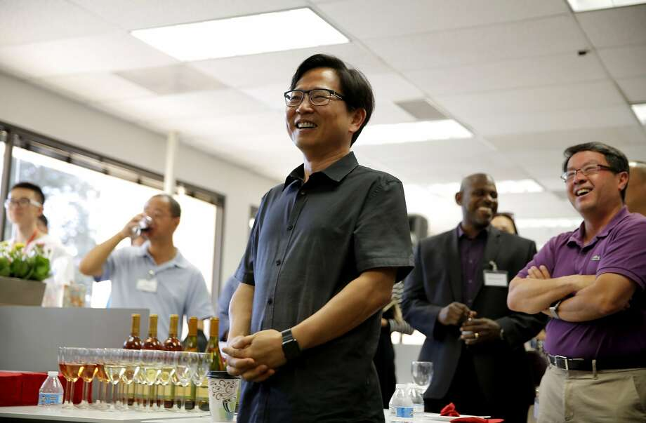 Chen Zhang, senior vice president, laughs during Rain Long's speech during the opening of JD.com's new headquarters in Santa Clara, California, on Sunday, Oct. 11, 2015. Photo: Connor Radnovich, The Chronicle