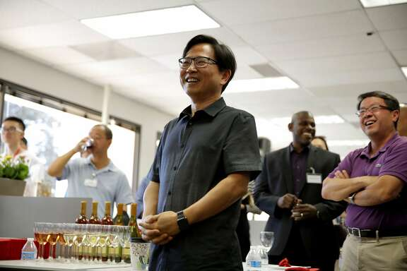 Chen Zhang, senior vice president, laughs during Rain Long's speech during the opening of JD.com's new headquarters in Santa Clara, California, on Sunday, Oct. 11, 2015.