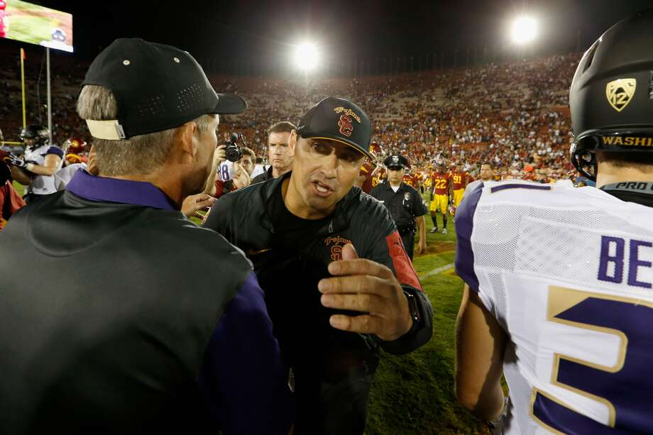 USC coach Steve Sarkisian embraces UW coach Chris Petersen after the Trojans fell 17-12 to the Huskies last week in Los Angeles. (Sean M. Haffey, Getty Images)