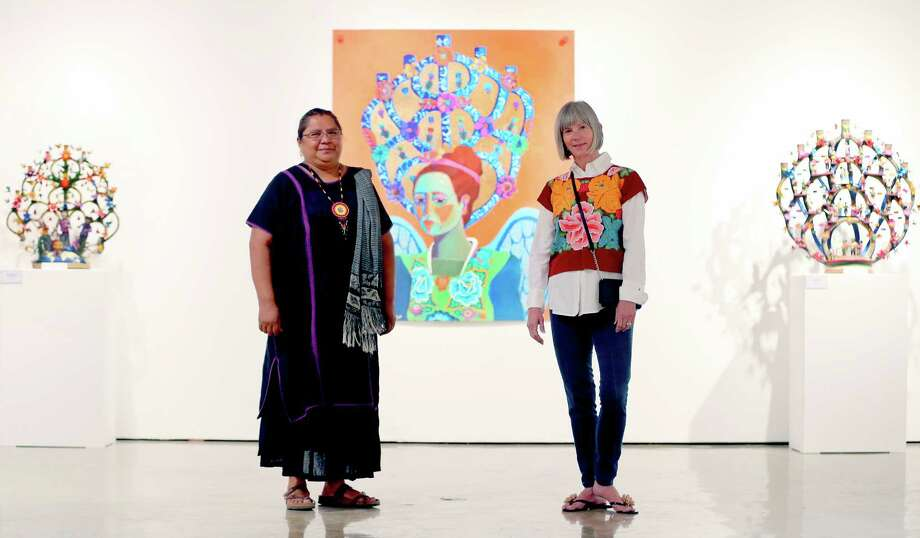 A new exhibit at the TAMU-SA Centro de Artes features ceramic works by Veronica Castillo (left), a folk artist who was awarded an NEA National Heritage Fellowship in 2013 and paintings and prints by Kathy Sosa. Photo: William Luther / San Antonio Express-News / © 2015 San Antonio Express-News