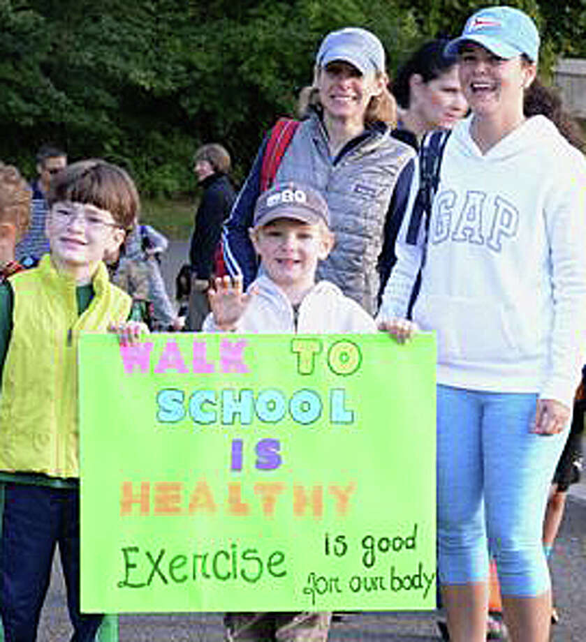 Holland Hill Elementary School sudents Joseph Balter and Matthew Ferrando, with their mothers Jen Ferrando and Luciane Balter, promote International Walk to School Day. Photo: Contributed / Contributed Photo / Fairfield Citizen