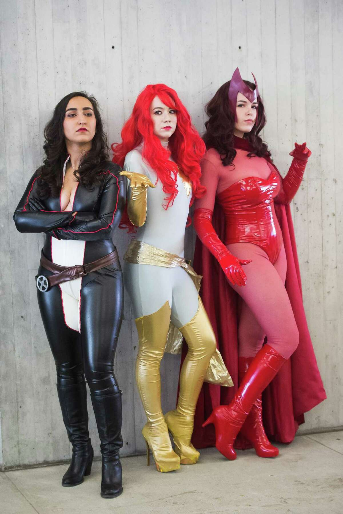 Costumed characters attend New York Comic Con at the Javits Center on Sunday, Oct. 11, 2015, in New York.