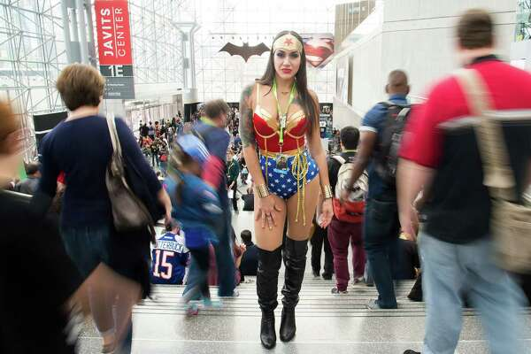 An attendee dressed as Wonder Woman walks the floor of New York Comic Con at the Javits Center on Friday, Oct. 9, 2015, in New York.