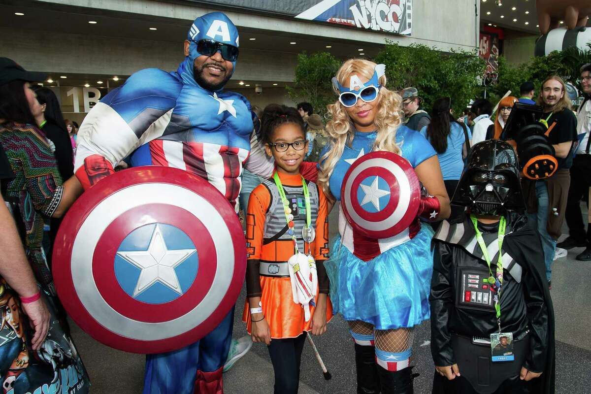 Costumed attendees walk the floor of New York Comic Con at the Javits Center on Friday, Oct. 9, 2015, in New York.