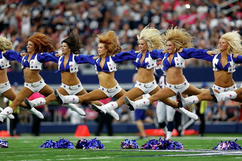 ARLINGTON, TX - OCTOBER 11: The Dallas Cowboys cheerleaders perform before a game against the New England Patriots at AT&T Stadium on October 11, 2015 in Arlington, Texas.