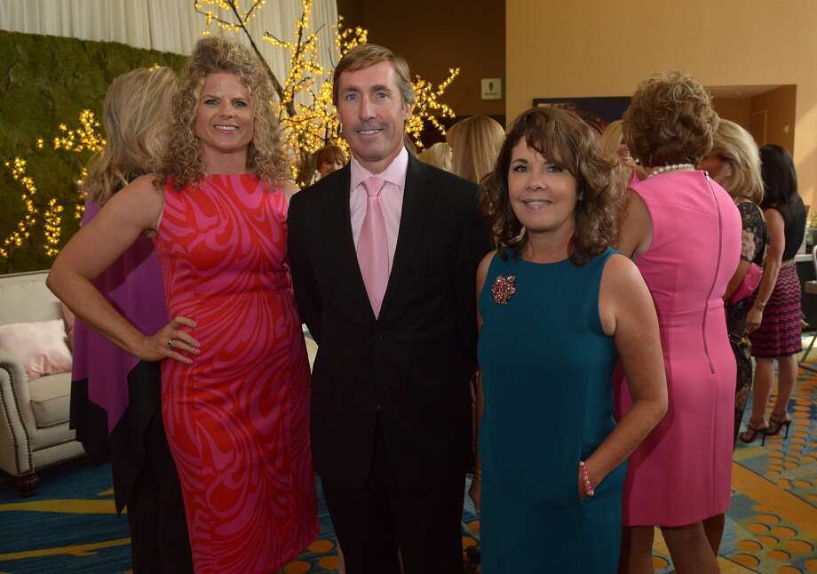 Josh Urban, center, chief executive officer at Memorial Hermann The Woodlands, teams-up with In the Pink of Health co-chairs Andrea Alexander, left, and Karey Miller-Bancroft team-up at their breast cancer awareness luncheon at The Woodlands Waterway Marriott & Convention Center on Friday, Oct. 9, 2015. The hospital has hosted the event for 15 years. Photo: Jerry Baker, For The Houston Chronicle
