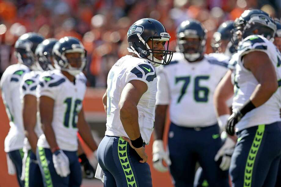Quarterback: It was a tale of two halves for Russell Wilson, who was nearly perfect in the Hawks' opening drive and in their two-minute drill at the end of the fist half. In the second half, as the Bengals' pass rush began to make an impact, he seemed to hear footsteps and bring the ball down before he needed to. Still, he was one big completion to Tyler Lockett away from putting the game away for Seattle. Grade: C- Photo: Andy Lyons, Getty Images / 2015 Getty Images