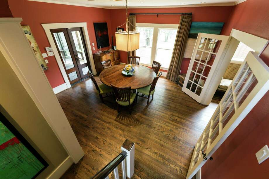 Vezey and Norwood were able to salvage many of the home's original doors, including these French doors that lead to the dining room. The glass panels still have their original wavy glass. Photo: Craig Hartley, Freelance / Copyright: Craig H. Hartley