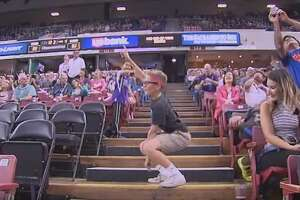 WATCH: 'Hilarious kid' dances his heart out at Spurs' preseason game - Photo
