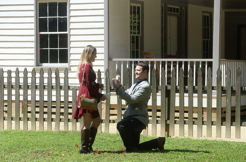 Jonathan Durr proposes to his girlfriend Rachel French on the grounds of the John Jay French Museum