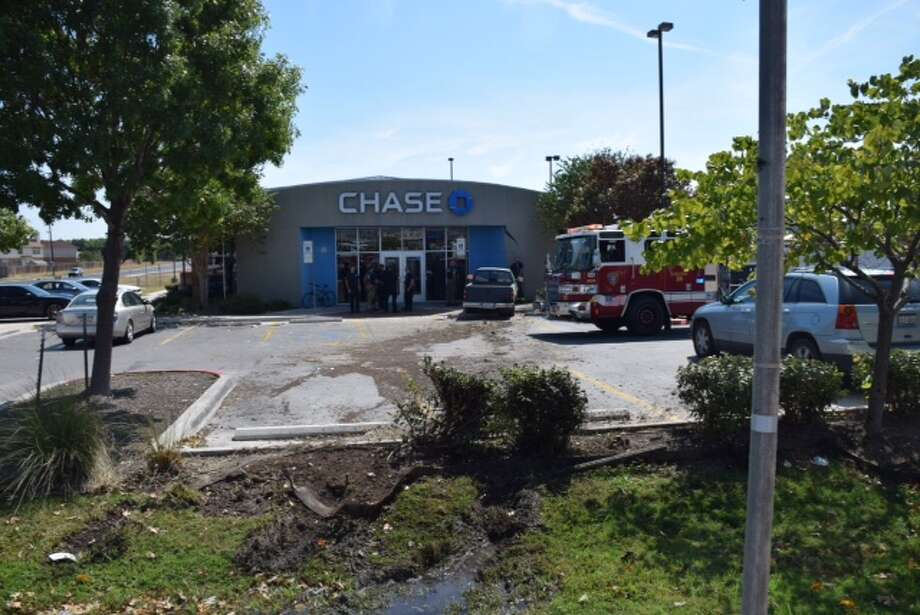 Emergency crews were called out to the Chase bank in the 6500 block of F.M. 78 just after a truck had barreled into the building, Oct. 12, 2015 Photo: By Mark D. Wilson/San Antonio Express-News