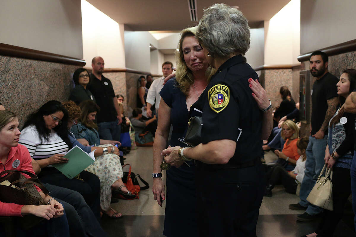 Bexar County Sheriff's Sgt. Yvonne Vann, left, is comforted by County Sheriff Susan Pamerleau during closing arguments of the Mark Anthony Gonzalez capital murder trial in the Bexar County 175th District Court, Monday, Oct. 12, 2015. Gonzalez is accused of killing Vann?•s husband, Bexar County Sheriff?•s Sgt. Kenneth Vann in May 2011.