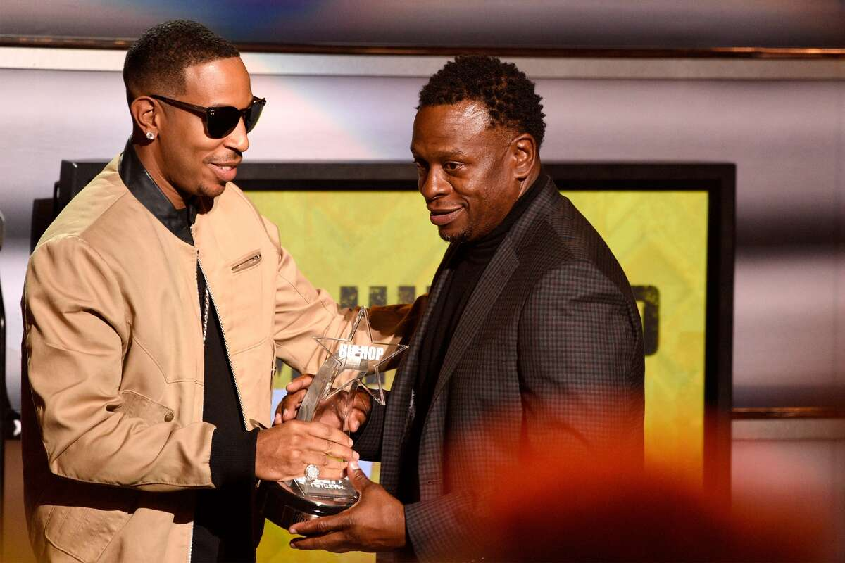 ATLANTA, GA - OCTOBER 09: Ludacris (L) presents award to Scarface onstage at the BET Hip Hop Awards Show 2015 at the Atlanta Civic Center on October 9, 2015 in Atlanta, Georgia. (Photo by Paul R. Giunta/BET/Getty Images for BET Networks)