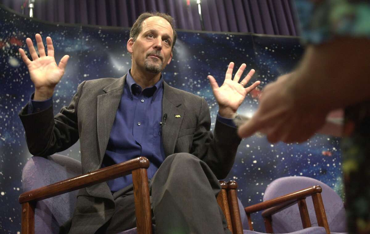 Dr. Geoffrey Marcy, astronomy professor at the University of California, Berkeley gestures as he speaks with the media at the National Aeoronautics and Space Administration (NASA) headquarters June 13, 2002 in Washington, DC.