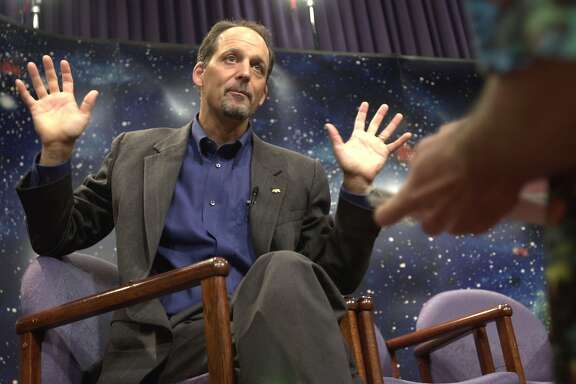 WASHINGTON - JUNE 13:  Dr. Geoffrey Marcy, astronomy professor at the University of California, Berkeley gestures as he speaks with the media at the National Aeoronautics and Space Administration (NASA) headquarters June 13, 2002 in Washington, DC. Dr. Marcy and Dr. Paul Butler of the Carnegie Institution of Washington announced their discovery of a Jupiter-like planet orbiting a Sun-like star in a neighboring solar system. The discovery is the first to demonstrate a solar system that is constructed similarly to Earth's solar system.  (Photo by Stefan Zaklin/Getty Images)