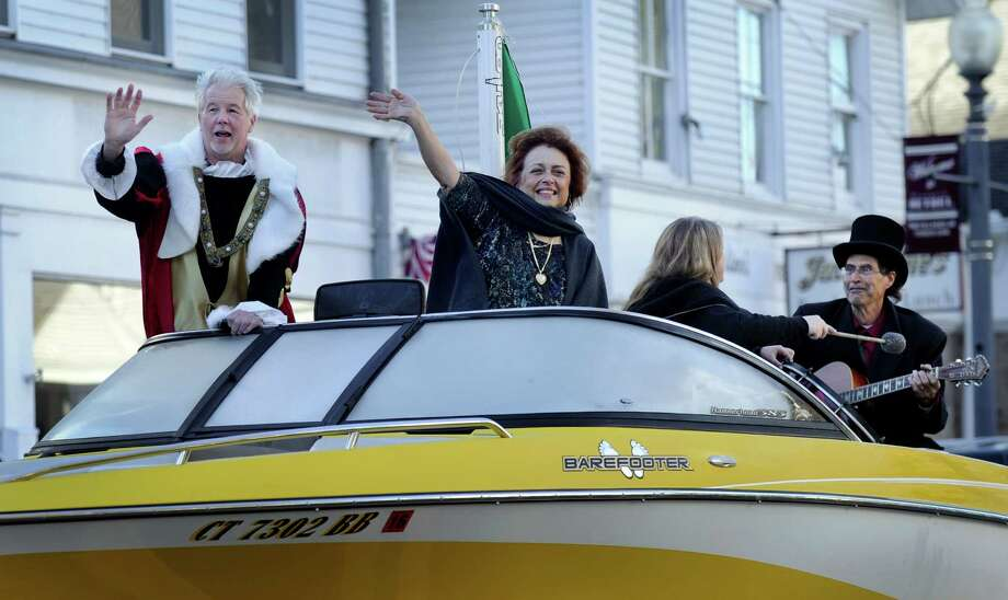 Rich Zuvich, left, as Christopher Columbus, and Gina Clarizio, as Queen Isabella of Spain, ride down Greenwood Avenue in Bethel Monday morning during the town's Columbus Day parade. Photo: Photos By Carol Kaliff / Hearst Connecticut Media / The News-Times