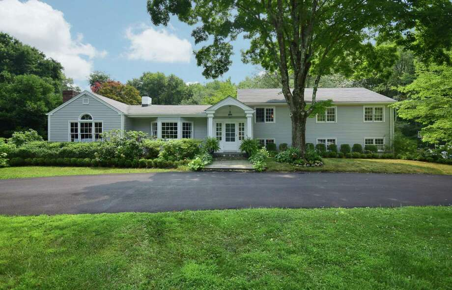 This 1954 home has was recently updated with a new circular driveway, interior and exterior painting and new kitchen appliances. Photo: Contributed / Contributed Photo / New Canaan News
