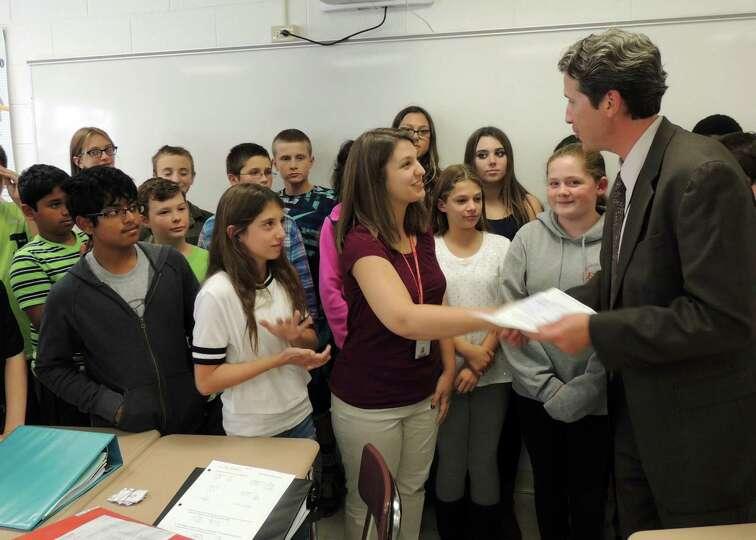 Farnsworth Middle School Principal Michael Laster presents Kathryn Matthews with her 2015 AFCEA Scie