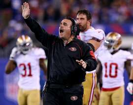 EAST RUTHERFORD, NJ - OCTOBER 11:  Head coach Jim Tomsula of the San Francisco 49ers directs his players in the fourth quarter against the New York Giants at MetLife Stadium on October 11, 2015 in East Rutherford, New Jersey.The New York Giants defeated the San Francisco 49ers 30-27.  (Photo by Elsa/Getty Images)